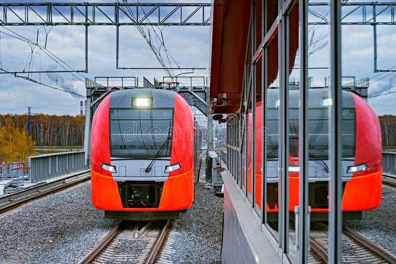 Highspeed train moves toward the station. Highspeed train moves toward the railway station royalty free stock photography