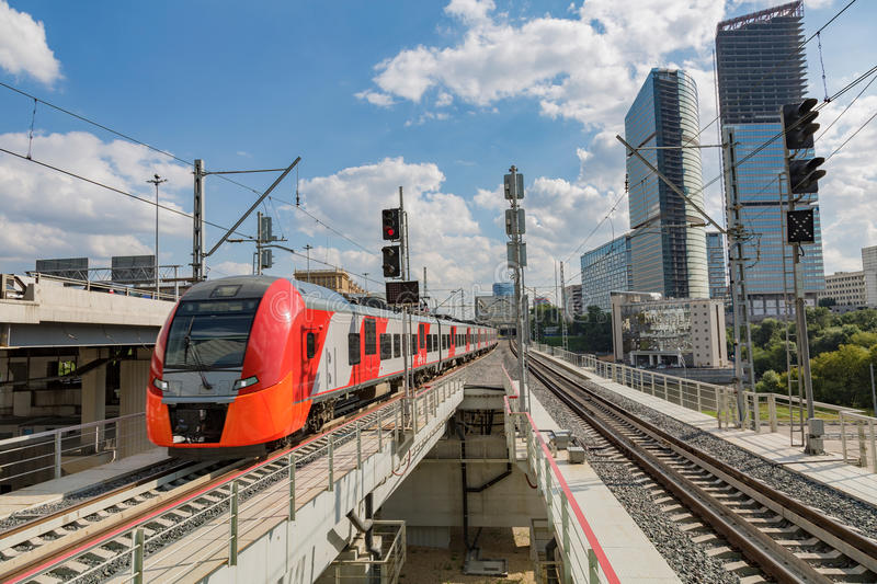 Highspeed train on a station. Highspeed passenger train arrives on the platform on a sunny summer day stock photography
