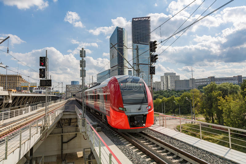 Highspeed train on a station. Highspeed passenger train arrives on the platform on a sunny summer day stock images