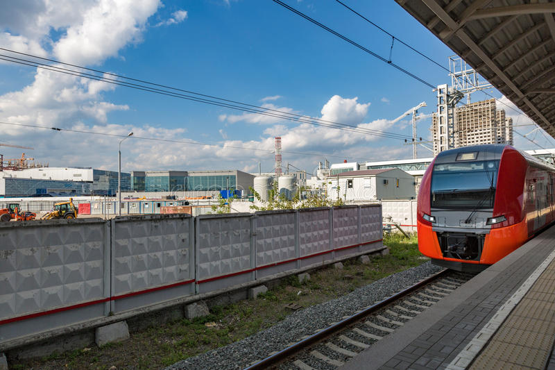 Highspeed train on a station. Highspeed passenger train arrives on the platform on a sunny summer day royalty free stock image