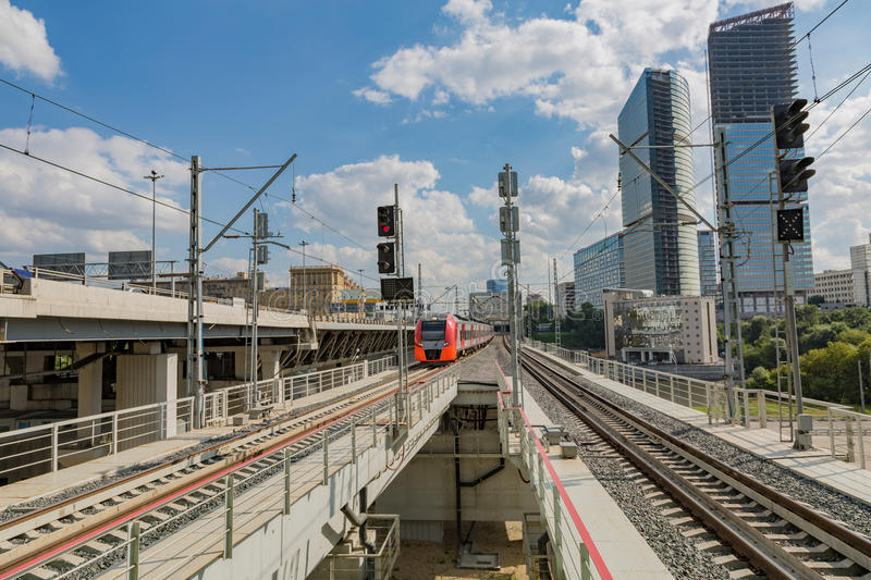 Highspeed train on a station. Highspeed passenger train arrives on the platform on a sunny summer day royalty free stock photos