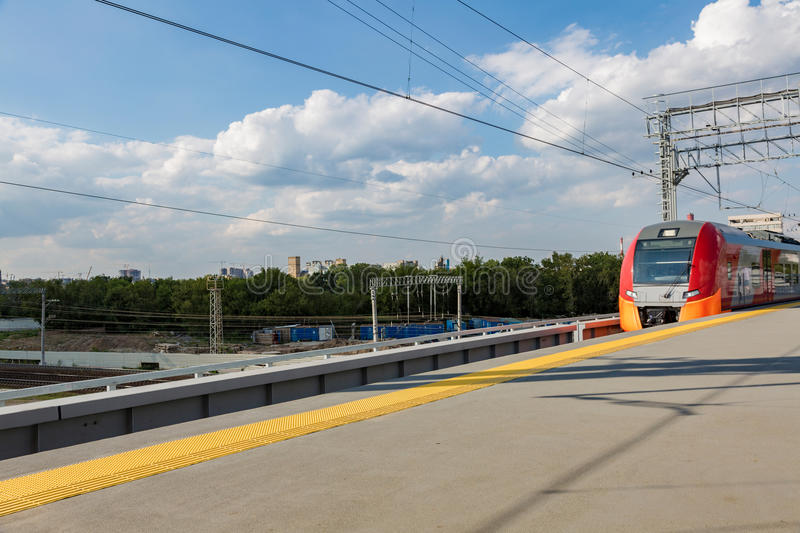 Highspeed train on a station. Highspeed passenger train arrives on the platform on a sunny summer day stock photos