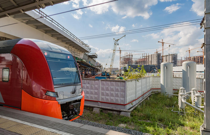 Highspeed train on a station. Highspeed passenger train arrives on the platform on a sunny summer day royalty free stock images