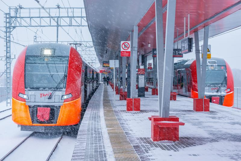 Highspeed trains stand by the Rostokino station platform. Moscow, Russia - January 20, 2018: Highspeed trains stand by the Rostokino station platform at stock images
