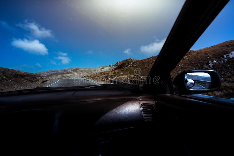 High contrast view of a landscape from the interior of a car royalty free stock image