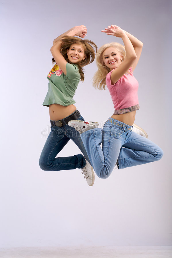 Free Hight Jumping Two Women Royalty Free Stock Photos - 5300128