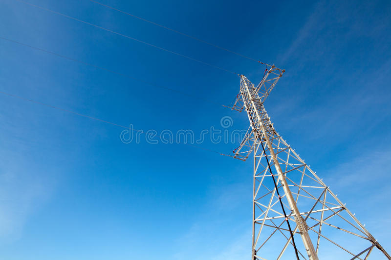 Hight voltage electrical tower against blue sky