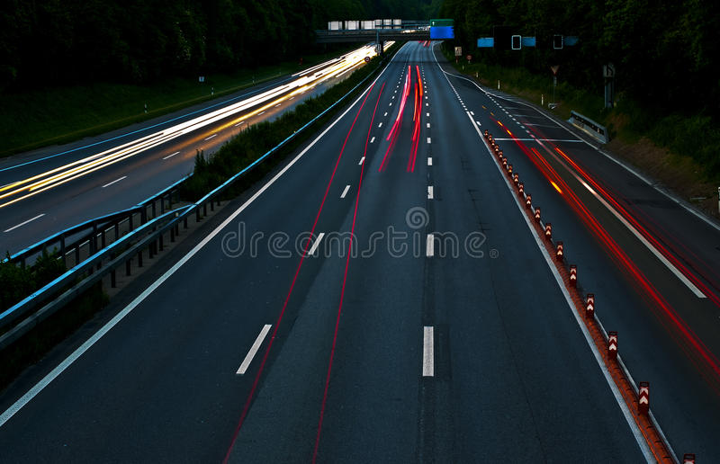 Highway. With light trails and blurs
