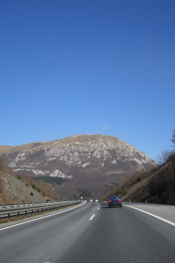 Highway. Low traffic highway in Europe, driving towards mountain stock photo