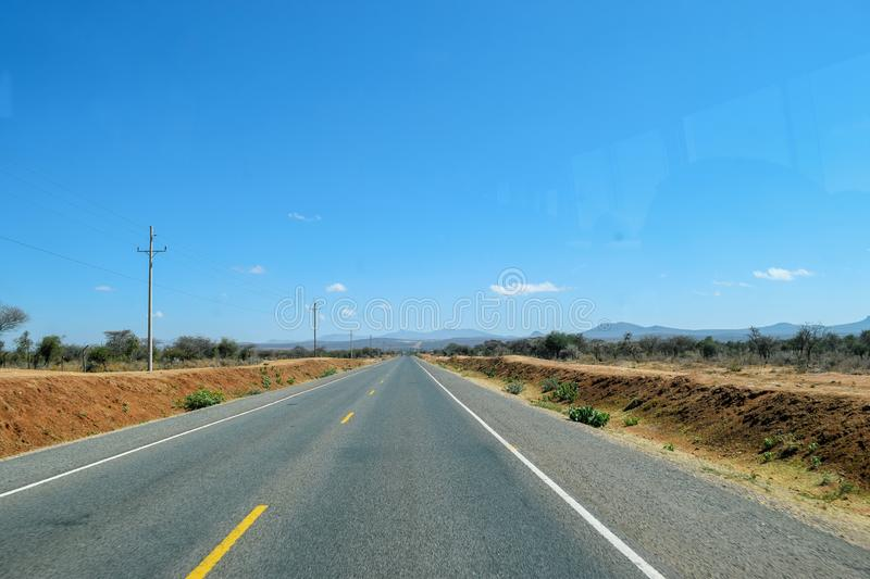 Highway against a mountain background, Tanzania. Highway on our way to Arusha Town, Tanzania royalty free stock photos