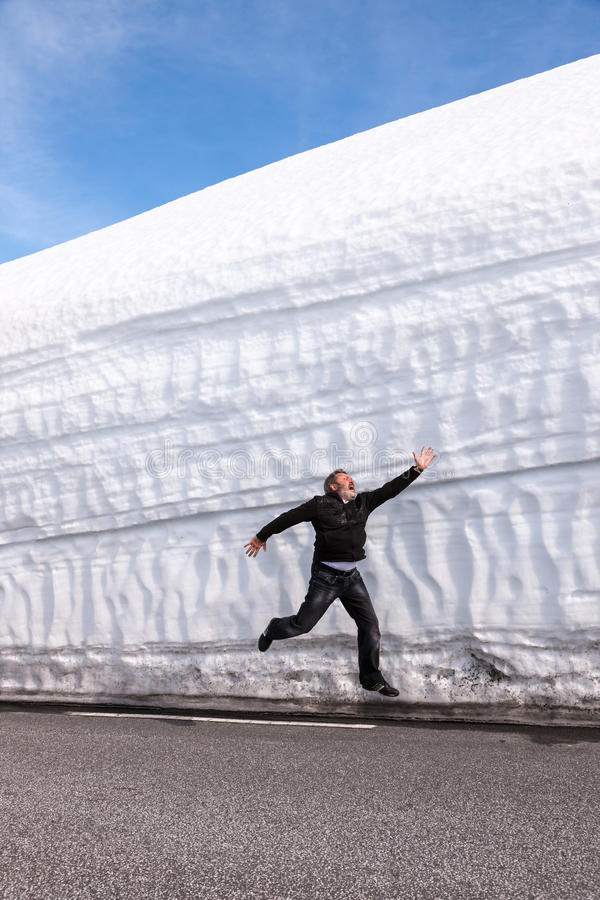 Highway along the snow wall. Norway in spring stock images