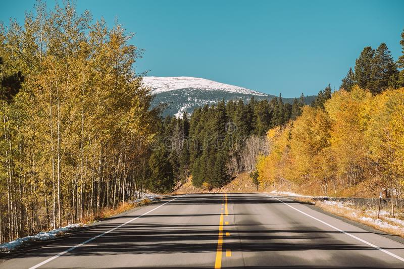Highway at autumn in Colorado, USA. Highway at autumn sunny day in Colorado, USA royalty free stock photos