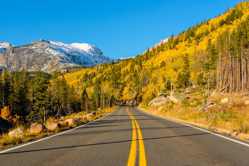 Highway at autumn in Colorado, USA. Highway at autumn sunny day in Rocky Mountain National Park. Colorado, USA royalty free stock photos