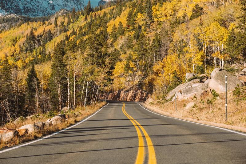 Highway at autumn in Colorado, USA. Highway at autumn sunny day in Rocky Mountain National Park. Colorado, USA stock photography