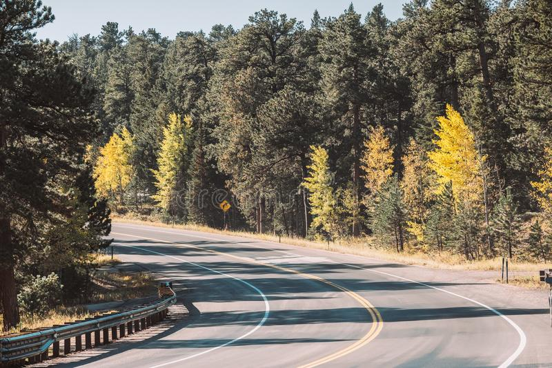 Highway at autumn in Colorado, USA. Season changing from autumn to winter. Highway in Colorado, USA stock photos