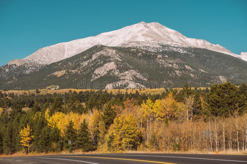 Highway at autumn in Colorado, USA. Season changing from autumn to winter. Highway in Colorado, USA stock image