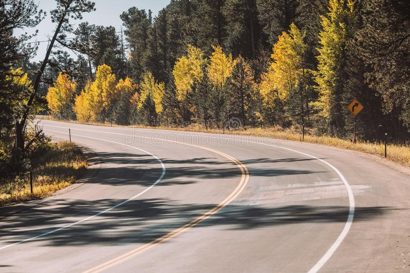 Highway at autumn in Colorado, USA. Season changing from autumn to winter. Highway in Colorado, USA stock images