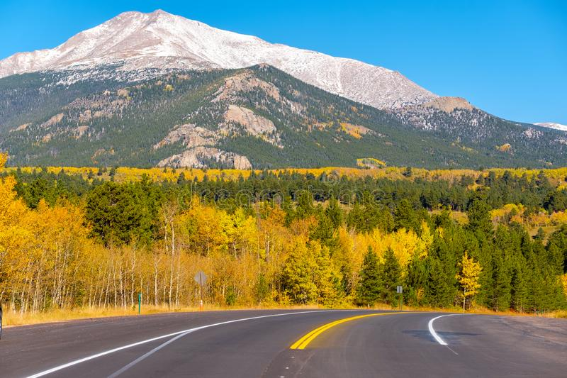 Highway at autumn in Colorado, USA. Season changing from autumn to winter. Highway in Colorado, USA royalty free stock photography