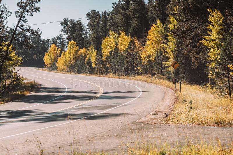 Highway at autumn in Colorado, USA. Season changing from autumn to winter. Highway in Colorado, USA stock photo
