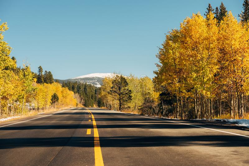 Highway at autumn in Colorado, USA. Highway at autumn sunny day in Colorado, USA stock photos