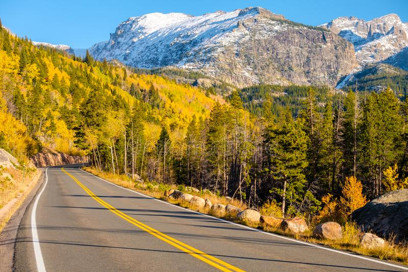 Highway at autumn in Colorado, USA. Highway at autumn sunny day in Rocky Mountain National Park. Colorado, USA stock photos