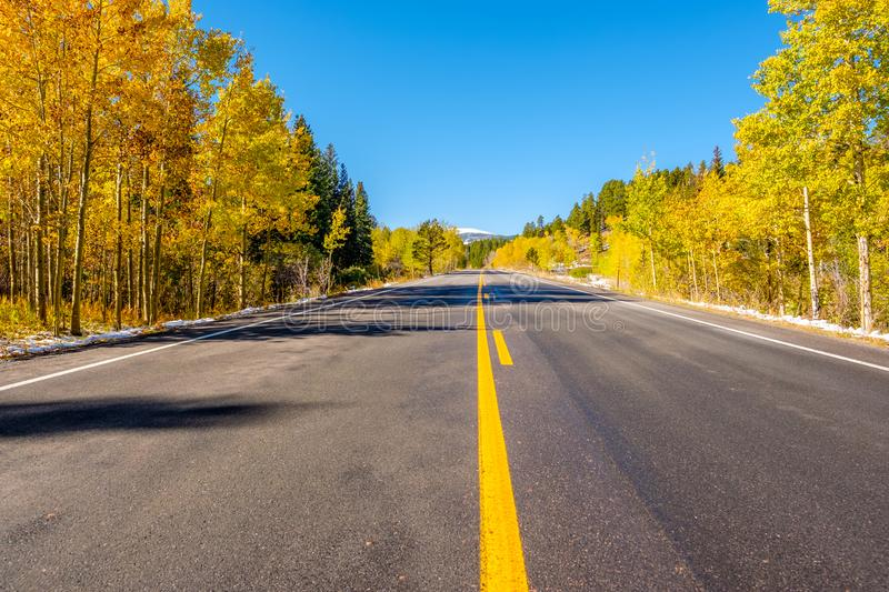Highway at autumn in Colorado, USA. Highway at autumn sunny day in Colorado, USA royalty free stock images