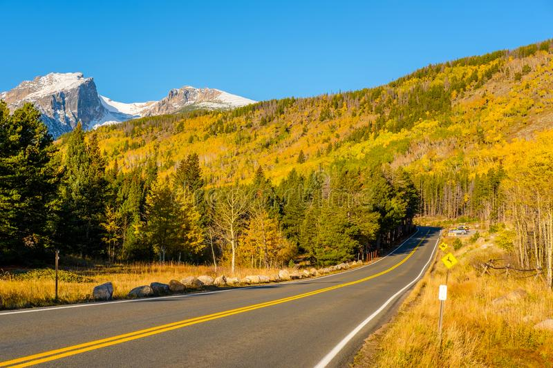 Highway at autumn in Colorado, USA. Highway at autumn sunny day in Rocky Mountain National Park. Colorado, USA stock images