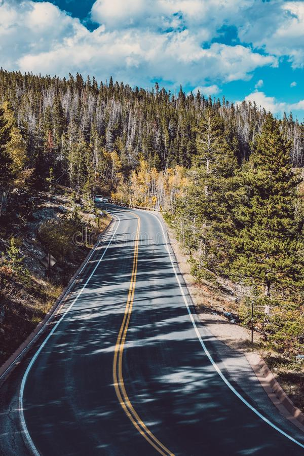 Highway at autumn in Colorado, USA. Highway at autumn sunny day in Rocky Mountain National Park. Colorado, USA royalty free stock photography