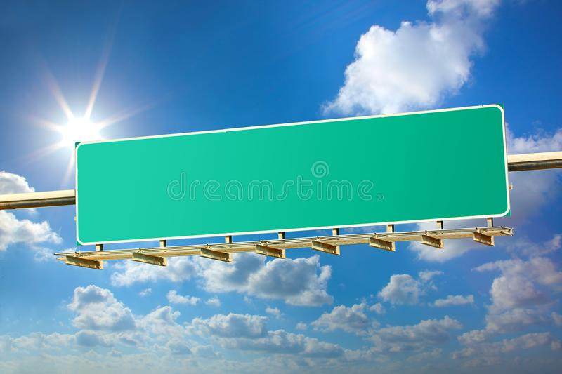 Highway blank sign. On sunny blue sky background stock images