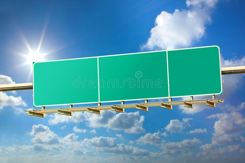 Highway blank sign. On sunny blue sky background stock photography