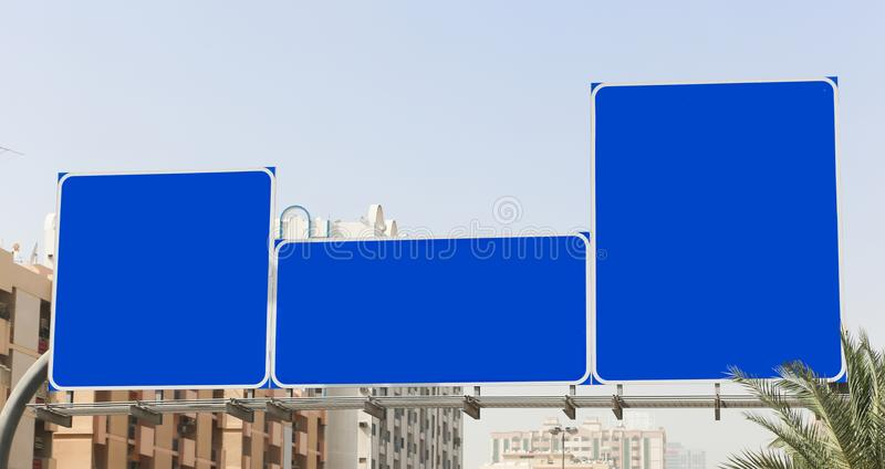 Street blank signs. Highway blank sign on sunny blue sky background stock images