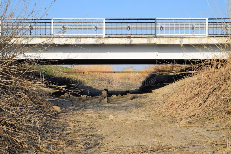 highway bridge over dry irrigation canal stock photo