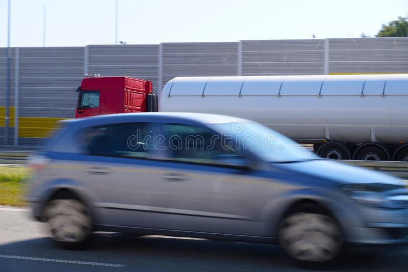 Highway. Cars passing by. Limitation of noise by means of sound. Cars passing by. Limitation of noise by means of sound absorbing barriers stock photos