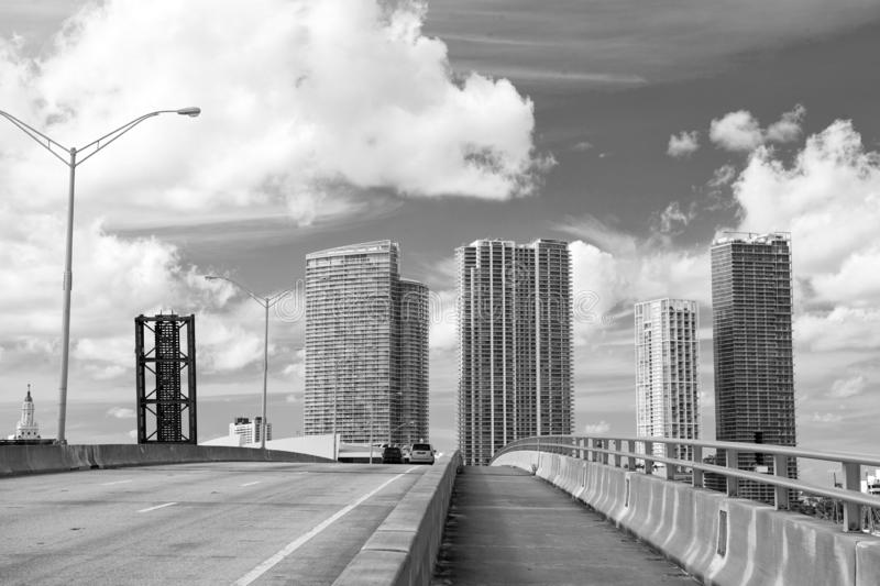 Highway with cars and skyscrapers of miami, usa. Road or roadway for transport traffic on cloudy blue sky. Public stock image