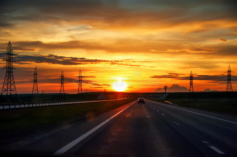 Highway with cars traveling on the sunset . stock photography