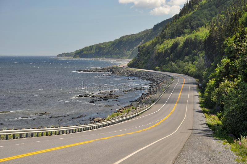 Highway 132 at the coast of Saint Lawrence River in Quebec, Canada. The route is part of the Gaspé Peninsula Gaspésie, a northward continuation of the royalty free stock photo
