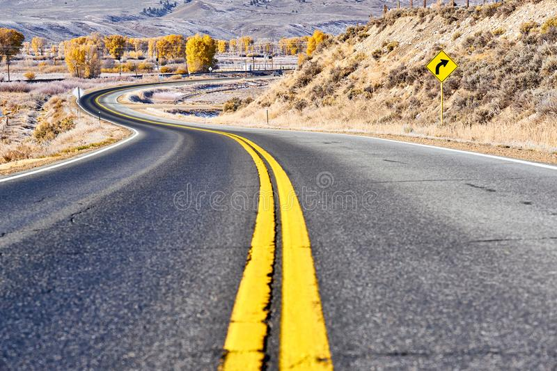 Highway at autumn in Colorado, USA. Highway in Colorado at autumn, USA royalty free stock photo