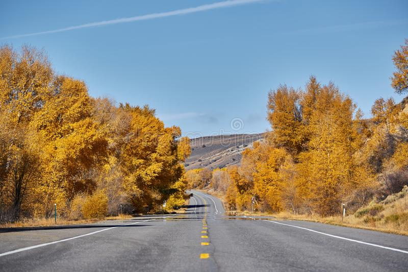 Highway at autumn in Colorado, USA. Highway in Colorado at autumn, USA royalty free stock photography