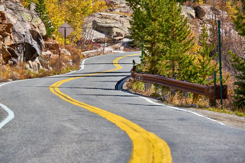 Highway at autumn in Colorado, USA. Highway in Colorado at autumn, USA royalty free stock images