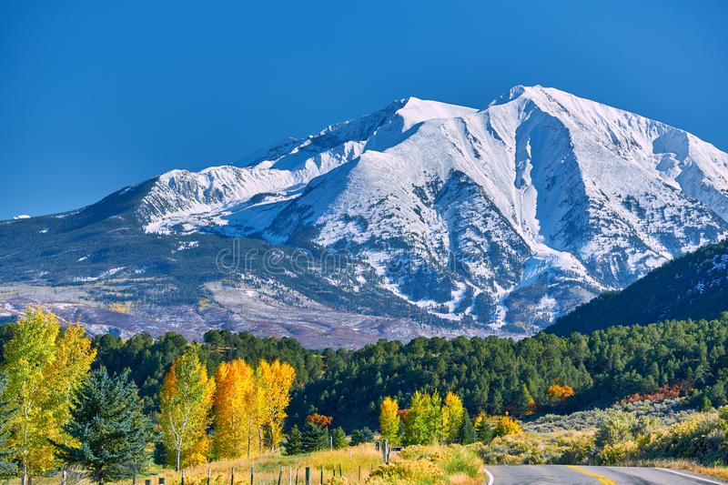 Highway at autumn in Colorado, USA. Highway in Colorado at autumn, USA. Mount Sopris landscape stock images