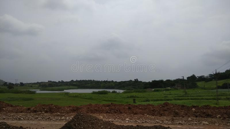 Highway construction work at hilly area in gujarat royalty free stock image