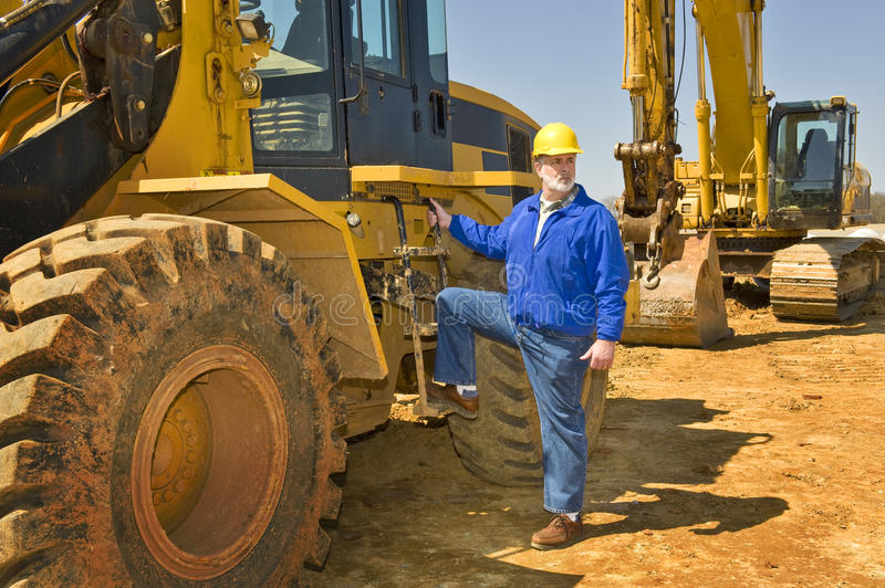 Highway Construction Worker With Equipment royalty free stock image
