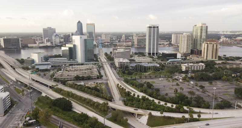 Highway 95 Cuts Through Downtown Jacksonville Florida. Light traffic exists before sunset in Jacksonville, Florida in this aerial view with St Johns River royalty free stock images