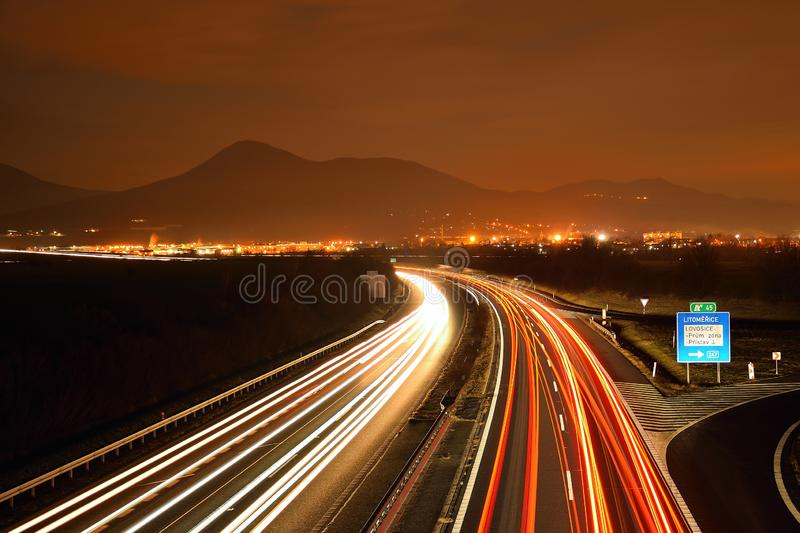 Highway D8 and Lovos hill on horizont in night on 16th january in czech republic royalty free stock photography