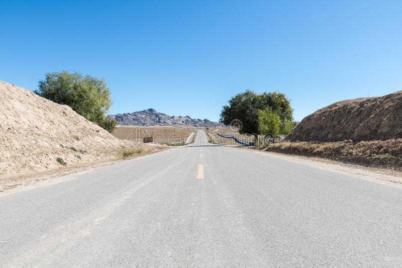 Highway through the desolate village royalty free stock photo