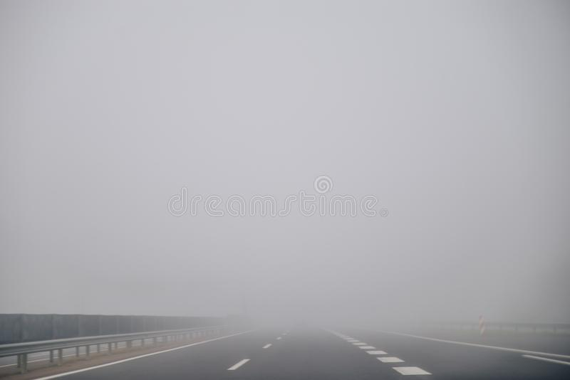 Highway in foggy time. In the morning stock photography
