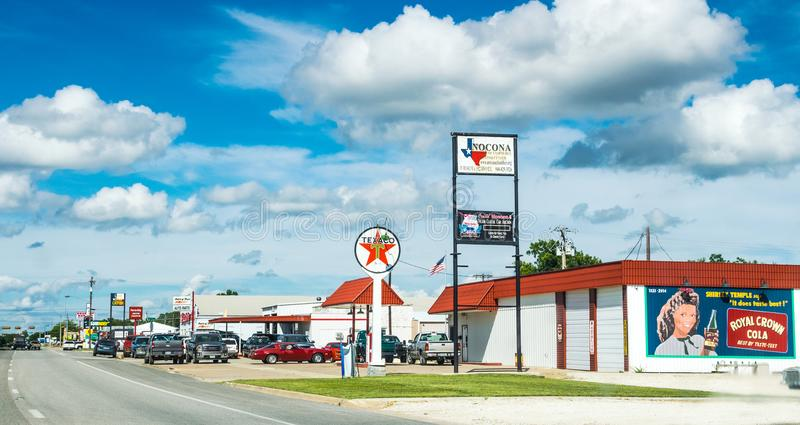 Highway and gas station in Clarksville, Texas. American way of life stock photography
