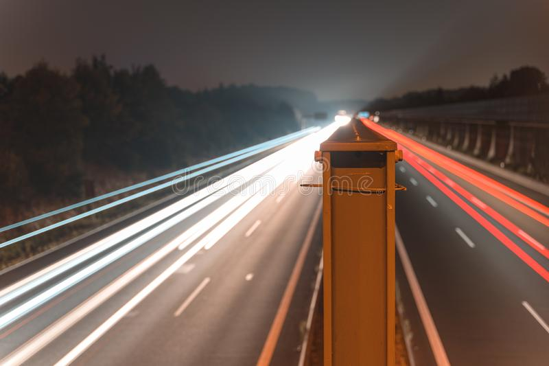 A4 Highway in Germany Chemnitz. Long time exposure of traffic on the move with close up of metal that seperates left and. Right with copy space stock photos