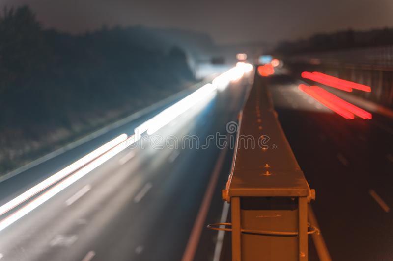 A4 Highway in Germany Chemnitz. Long time exposure of traffic on the move with close up of metal that seperates left and. Right with copy space stock photo