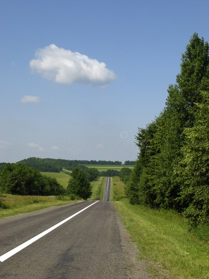 Highway in hilly district. Summer day royalty free stock photo